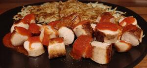 Galettes de pomme de terre et Currywurst
